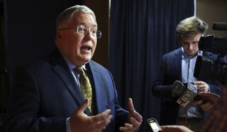 In this Nov. 1, 2018, file photo, Patrick Morrisey speaks to reporters after a debate in Morgantown, W.Va. Attorneys generals from 18 states are urging the U.S. Supreme Court to allow construction of the Atlantic Coast Pipeline to continue. West Virginia Attorney General Morrisey says his office will lead the coalition in the friend of the court brief scheduled to be filed Monday, Dec. 9, 2019. (AP Photo/Raymond Thompson, File)