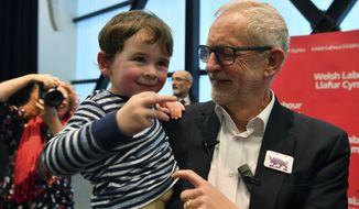 Labour Leader Jeremy Corbyn interacts with three years old Noa Williams Roberts after addressing a members' rally at Bangor University, while on the General Election campaign trail in Bangor, Wales, Sunday, Dec. 8, 2019. Britain goes to the polls on Dec. 12. (Ben Birchall/PA via AP)