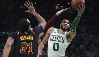 Boston Celtics forward Jayson Tatum (0) drives to the basket against Cleveland Cavaliers forward John Henson (31) during the second half of an NBA basketball game in Boston, Monday, Dec. 9, 2019. The Celtics won 110-88. (AP Photo/Charles Krupa)