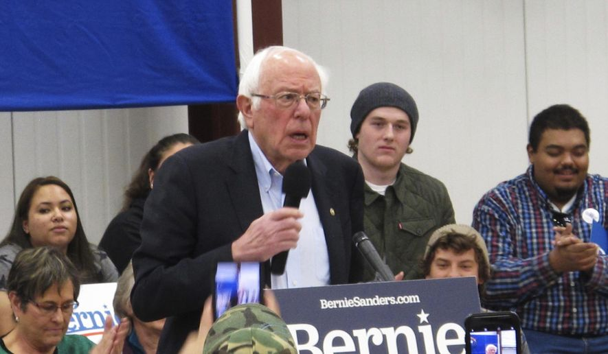 """Democratic presidential hopeful Bernie Sanders speaks before about 200 people at a rally at a community center on tribal land in Carson City, Nev., Monday, Dec. 9, 2019. He said Monday he believes he has """"an excellent"""" chance to win in all three early presidential-selection states of Nevada, Iowa and New Hampshire. (AP Photo/Scott Sonner)"""