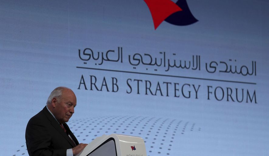 """Former U.S. Vice President Dick Cheney talks to the audience at the Arab Strategy Forum in Dubai, United Arab Emirates, Monday, Dec. 9, 2019. Cheney warned Monday that """"American disengagement"""" in the Middle East will benefit only Iran and Russia, indirectly criticizing President Donald Trump's pledges to pull forces out of the region. (AP Photo/Kamran Jebreili)"""