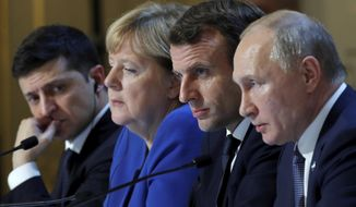 Ukraine's President Volodymyr Zelenskiy, left, German Chancellor Angela Merkel, French President Emmanuel Macron, third left and Russian President Vladimir Putin, right, attend a joint news conference at the Elysee Palace in Paris, Monday Dec. 9, 2019. Russian President Vladimir Putin and Ukrainian President Volodymyr Zelenskiy met for the first time Monday at a summit in Paris to try to end five years of war between Ukrainian troops and Russian-backed separatists. (Charles Platiau/Pool via AP)