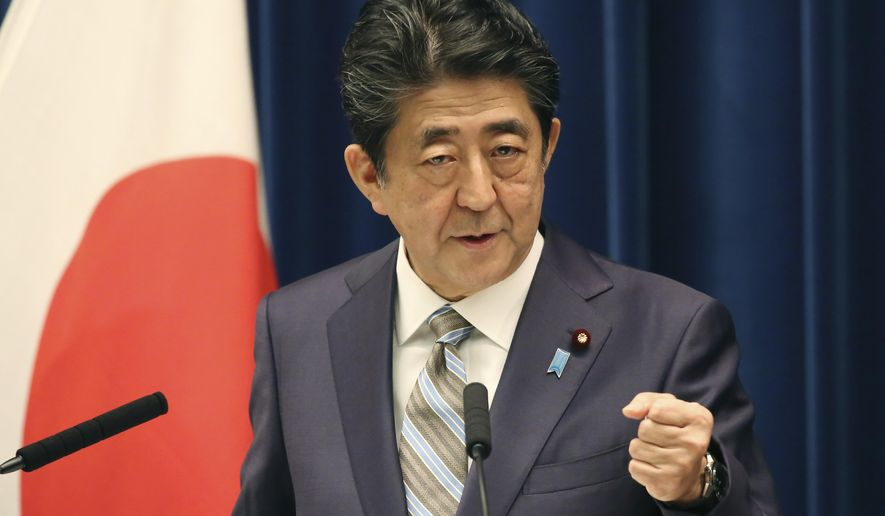 Japanese Prime Minister Shinzo Abe speaks during a press conference in Tokyo, Monday, Dec. 9, 2019. Abe said his country is arranging Iranian President Hassan Rouhani's visit to Japan as the country seeks to play a greater role in relieving tension in the Middle East where Japanese oil imports mainly come from. (AP Photo/Koji Sasahara)