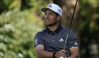 FILE - In this Oct. 26, 2019, file photo, Xander Schauffele of the United States watches his tee shot on the 12th hole during the second round of the Zozo Championship PGA Tour at the Accordia Golf Narashino country club in Inzai, east of Tokyo, Japan. Schauffele, often an afterthought among young American stars, makes his U.S. team debut at the Presidents Cup this week. (AP Photo/Lee Jin-man, File)