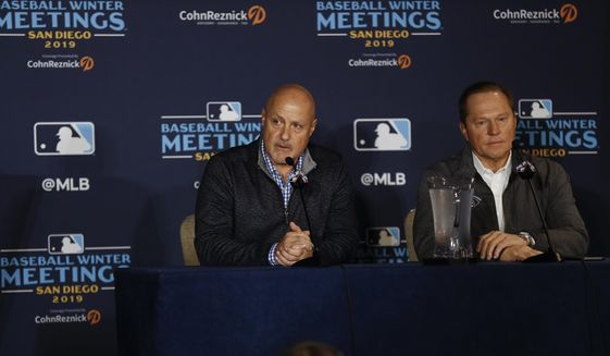 Washington Nationals general manager Mike Rizzo, left, listens to a question alongside agent Scott Boras, right, during the Major League Baseball winter meetings Monday, Dec. 9, 2019, in San Diego. Nationals pitcher and World Series MVP Stephen Strasburg agreed to a record $245 million, seven-year contract on Monday. (AP Photo/Gregory Bull)  **FILE**