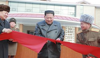 "In this Dec. 7, 2019, photo provided by the North Korean government, North Korean leader Kim Jong Un, center, cuts the ribbon during a ceremonial opening of the Yangdok Hot Spring Cultural Recreation Center in South Pyongan Province, North Korea. Independent journalists were not given access to cover the event depicted in this image distributed by the North Korean government. The content of this image is as provided and cannot be independently verified. Korean language watermark on image as provided by source reads: ""KCNA"" which is the abbreviation for Korean Central News Agency. (Korean Central News Agency/Korea News Service via AP)"