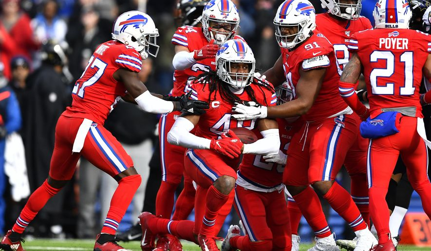 Buffalo Bills middle linebacker Tremaine Edmunds, center, celebrates after intercepting a pass by Baltimore Ravens quarterback Lamar Jackson (8) during the first half of an NFL football game in Orchard Park, N.Y., Sunday, Dec. 8, 2019. (AP Photo/Adrian Kraus)