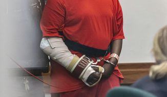 Tyrone Smith, a suspect in the Dec. 2 Waukesha South High School shooting incident, makes an appearance at the Waukesha County Courthouse on Monday, Dec. 9, 2019. Smith, 18, faces several charges, including second-degree recklessly endangering safety,' obstructing an officer, disorderly conduct and dangerous weapons on school premises.  (Scott Ash/Milwaukee Journal-Sentinel via AP)