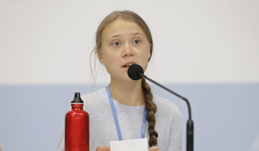Climate activist Greta Thunberg speaks during a news conference at the COP25 climate summit in Madrid, Spain, Monday, Dec. 9, 2019. Thunberg is in Madrid where a global U.N.-sponsored climate change conference is taking place. (AP Photo/Andrea Comas)