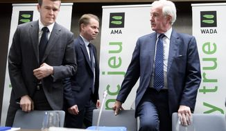 President-Elect of World Anti-Doping Agency (WADA) Witold Banka, left, President of World Anti-Doping Agency (WADA) Craig Reedie, right, and Director General of World Anti-Doping Agency (WADA) Olivier Niggli, center, arrive for a press conference after the WADA's extraordinary Executive Committee (ExCo) on the Russian doping data manipulation, in Lausanne, Switzerland, Monday, Dec. 9, 2019. WADA bans Russia from international sporting events for four years. (Laurent Gillieron/Keystone via AP)