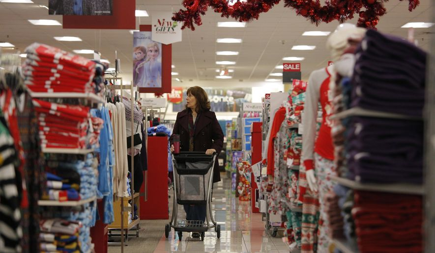 FILE - In this Nov. 27, 2019, filephoto Robin Hazal shops at a Kohl's ahead of Black Friday in Las Vegas. New data on U.S. retail sales will provide another view of how the holiday shopping season is going. Economists predict the Commerce Department will report Friday that retail sales rose 0.4% in November. (AP Photo/John Locher, File)