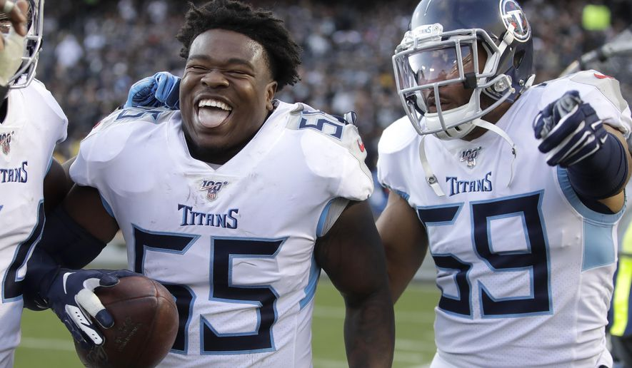 Tennessee Titans inside linebacker Jayon Brown (55) celebrates with inside linebacker Wesley Woodyard (59) after scoring against the Oakland Raiders during the second half of an NFL football game in Oakland, Calif., Sunday, Dec. 8, 2019. (AP Photo/Ben Margot)