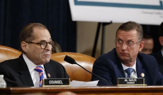 House Judiciary Committee Chairman Rep. Jerrold Nadler, D-N.Y., left, gives his closing statement as ranking member Rep. Doug Collins, R-Ga., listens during the House Judiciary Committee hearing on the constitutional grounds for the impeachment of President Donald Trump, on Capitol Hill in Washington, Wednesday, Dec. 4, 2019 (AP Photo/Alex Brandon) **FILE**