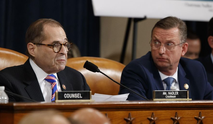 House Judiciary Committee Chairman Rep. Jerrold Nadler, D-N.Y., left, gives his closing statement as ranking member Rep. Doug Collins, R-Ga., listens during the House Judiciary Committee hearing on the constitutional grounds for the impeachment of President Donald Trump, on Capitol Hill in Washington, Wednesday, Dec. 4, 2019 (AP Photo/Alex Brandon)