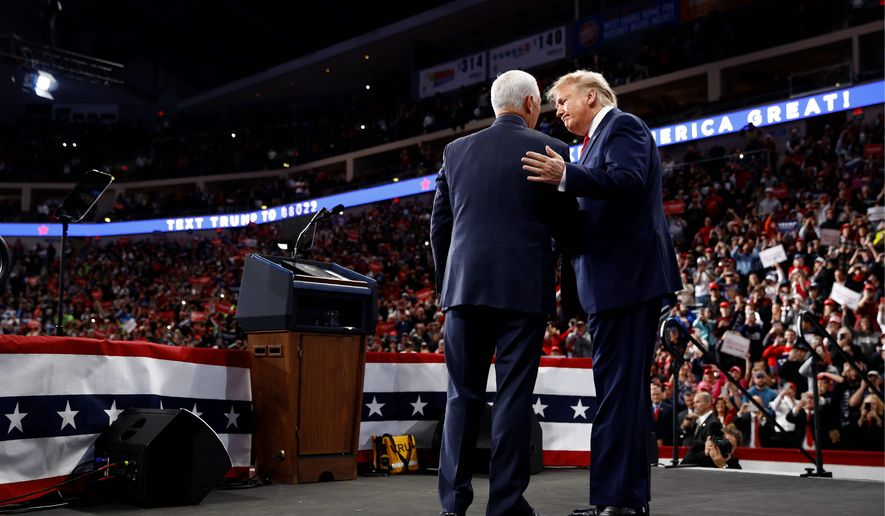 President Trump and Vice President Mike Pence railed against articles of impeachment during a campaign rally on Tuesday in Hershey, Pennsylvania. (Associated Press)