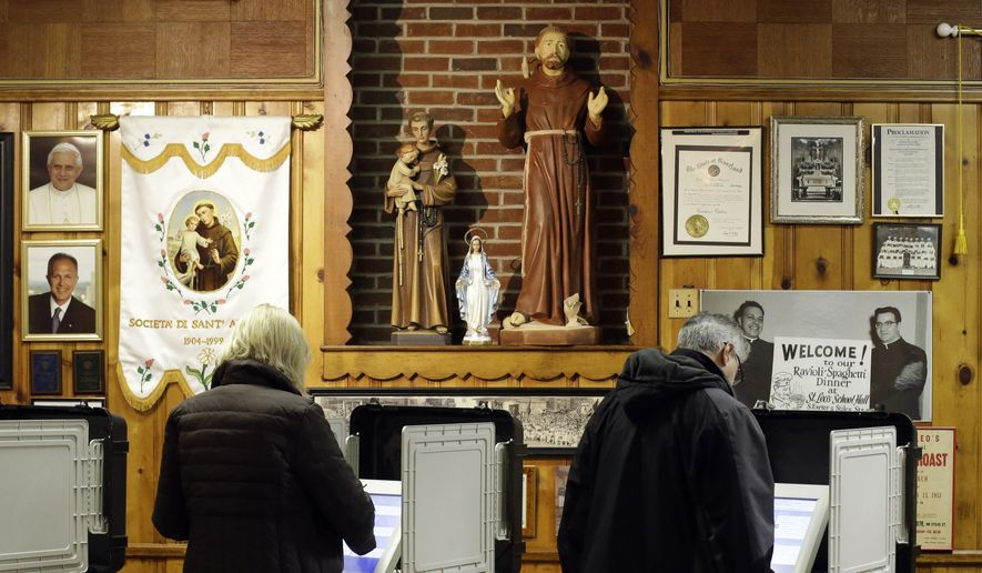 Voters cast their ballots at a polling place inside St. Leo's Catholic Church in Baltimore on Election Day, Tuesday, Nov. 6, 2012. (AP Photo/Patrick Semansky) **FILE**