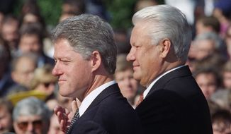 President Bill Clinton and Russian President Boris Yeltsin during an arrival ceremony for the Russian president on the South Lawn of the White House in Washington, Sept. 27, 1994. (AP Photo/Joe Marquette)