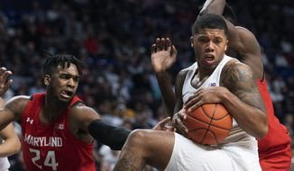 Penn State guard Myles Dread, right, beats Maryland forward Donta Scott (24) to a rebound in the first half of an NCAA college basketball game in State College, Pa., on Tuesday, Dec. 10, 2019. (AP Photo/Barry Reeger)