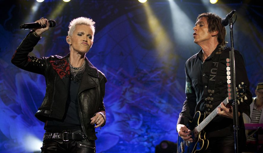 In this Saturday, April 16, 2011, photo Marie Fredriksson and Per Gessle, right, of Swedish Pop band Roxette perform during a concert in Rio de Janeiro, Brazil. Fredriksson has died, aged 61 after a long illness, according to an announcement Tuesday, Dec. 10, 2019. (AP Photo/Victor R. Caivano) **FILE**