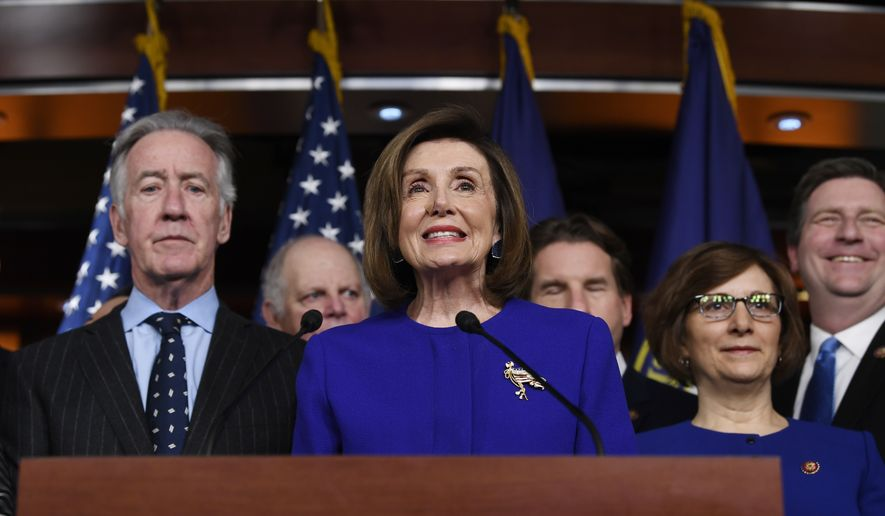 House Speaker Nancy Pelosi of Calif., accompanied by House Ways and Means Committee Chairman Richard Neal, D-Mass., speaks at a news conference on Capitol Hill in Washington, Tuesday, Dec. 10, 2019, on Capitol Hill in Washington. (AP Photo/Susan Walsh)