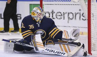Buffalo Sabres goalie Linus Ullmark (35) makes a save during the second period of an NHL hockey game against the St. Louis Blues, Tuesday, Dec. 10, 2019, in Buffalo, N.Y. (AP Photo/Jeffrey T. Barnes)