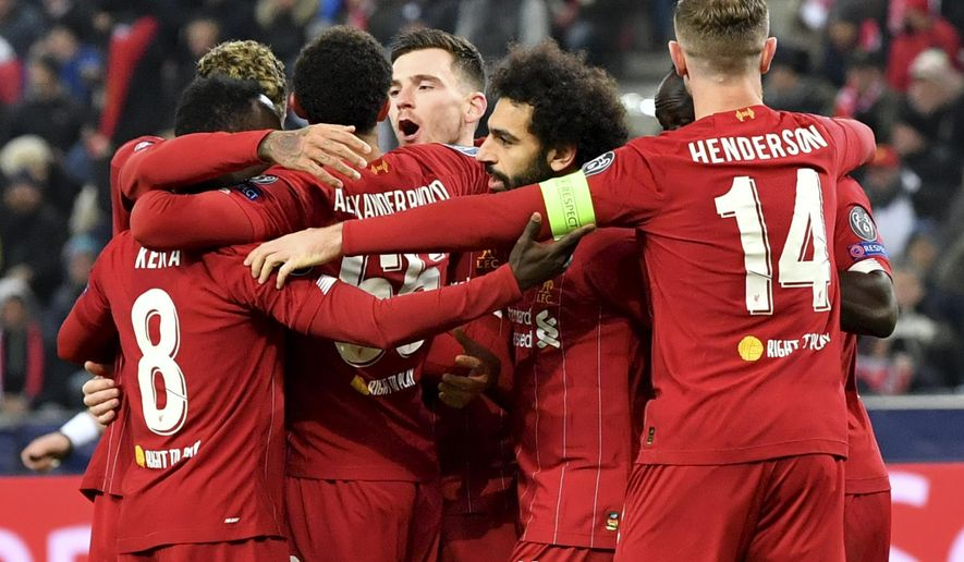 Liverpool's Naby Keita, left, celebrates with teammates after scoring his side's opening goal during the group E Champions League soccer match between Salzburg and Liverpool, in Salzburg, Austria, Tuesday, Dec. 10, 2019. (AP Photo/Kerstin Joensson)