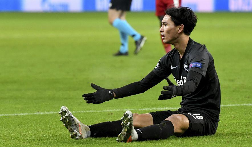 Salzburg's Takumi Minamino reacts during the group E Champions League soccer match between Salzburg and Liverpool, in Salzburg, Austria, Tuesday, Dec. 10, 2019. (AP Photo/Kerstin Joensson)