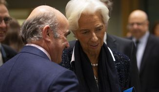 New President of European Central Bank Christine Lagarde, right, talks to European Central Bank Vice President Luis de Guindos during a Finance Ministers Eurogroup meeting at the European Council headquarters in Brussels, Friday, Nov. 8, 2019. (AP Photo/Francisco Seco)