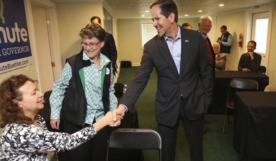FILE - In this Nov. 5, 2018, file photo, Knute Buehler, center, then a Republican candidate for Oregon governor, thanks campaign workers at his office during a tour of the state in Eugene, Ore. Buehler has has announced his candidacy for a seat in the U.S. House being vacated by Republican Greg Walden. (Chris Pietsch/The Register-Guard via AP, file)