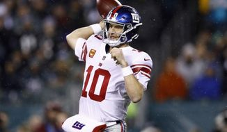 New York Giants' Eli Manning passes during the second half of an NFL football game against the Philadelphia Eagles, Monday, Dec. 9, 2019, in Philadelphia. (AP Photo/Matt Rourke)