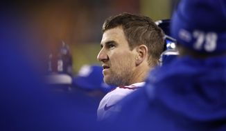 New York Giants' Eli Manning looks on from the sidelines during the first half of an NFL football game against the Philadelphia Eagles, Monday, Dec. 9, 2019, in Philadelphia. (AP Photo/Matt Rourke)