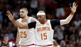 Atlanta Hawks guard Vince Carter (15) acknowledges the crowd as he is introduced during the first half of an NBA basketball game against the Miami Heat, Tuesday, Dec. 10, 2019, in Miami. (AP Photo/Lynne Sladky)