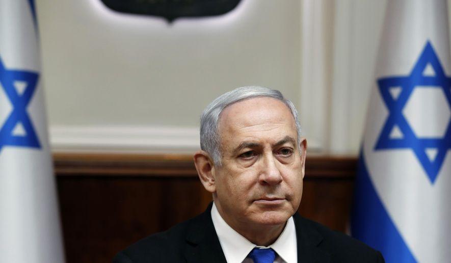 Israeli Prime Minister Benjamin Netanyahu attends the weekly cabinet meeting in Jerusalem on Sunday, Dec. 8, 2019. (Ronen Zvulun/ Pool photo via AP)