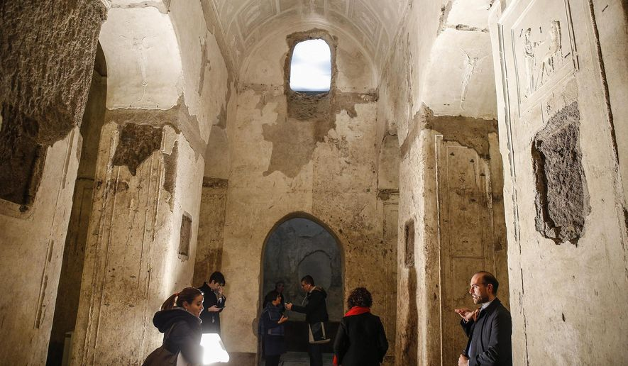 An inside view of the underground Basilica of Porta Maggiore following restoration work, in Rome, Tuesday, Dec. 10, 2019. An ancient underground basilica that only came to light a century ago has gotten a face-lift in Rome. The structure, near a gateway to ancient Rome known as Porta Maggiore, dates from the 1st Century. (Fabio Frustaci/ANSA via AP)