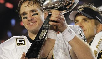 FILE - In this Feb. 7, 2010, file photo, New Orleans Saints quarterback Drew Brees celebrates with the Vince Lombardi Trophy after the Saints' 31-17 win over the Indianapolis Colts in the NFL Super Bowl XLIV football game in Miami. As part of its celebration of its 100th season, the NFL is designating a Game of the Week, each chosen to highlight a classic matchup. For this week, it is the Colts-Saints game. (AP Photo/Julie Jacobson, File)