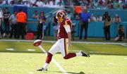 In this Oct. 13, 2019, file photo, Washington Redskins' Tress Way (5) punts during the first half at an NFL football game against the Miami Dolphins, in Miami Gardens, Fla. A popular Redskins podcast is trying to send Washington punter Tress Way to the Pro Bowl. Way leads all NFC punters in net yards and has pinned opponents inside the 20-yard line 24 times this season. (AP Photo/Wilfredo Lee, File) **FILE**