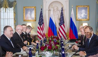 Secretary of State Mike Pompeo, left, is seated with Russian Foreign Minister Sergey Lavrov, right, before their meeting at the State Department, Tues. Dec. 10, 2019 in Washington. (AP Photo/Alex Brandon)