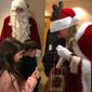 Santa Claus and Mrs. Claus, both officers of the Montgomery County Police Department, visited young patients Wednesday at The Children's Inn at the National Institutes of Health. The Children's Inn provides free lodging and services to children and families with rare and serious illnesses who are part of ongoing clinical trials or research studies. (Shen Wu Tan/The Washington Times)