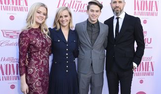 Ava Phillippe, from left, Reese Witherspoon, Deacon Phillippe and Jim Toth arrive at The Hollywood Reporter's Women in Entertainment Breakfast Gala on Wednesday, Dec. 11, 2019, in Los Angeles. (Photo by Jordan Strauss/Invision/AP)