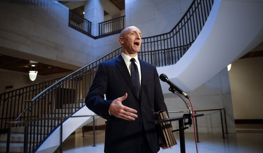 Carter Page, a foreign policy adviser to Donald Trump's 2016 presidential campaign, speaks with reporters following a day of questions from the House Intelligence Committee on Thursday, Nov. 2, 2017, on Capitol Hill in Washington. (AP file Photo/J. Scott Applewhite, File)