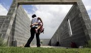 A woman who is in the country illegally plays with her 2-year-old daughter who was born in the United States. (AP Photo/Eric Gay, File)