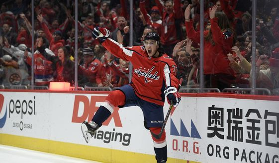 Washington Capitals right wing T.J. Oshie (77) celebrates his goal during the second period of an NHL hockey game against the Boston Bruins, Wednesday, Dec. 11, 2019, in Washington. This was Oshie's second goal of the night. (AP Photo/Nick Wass)