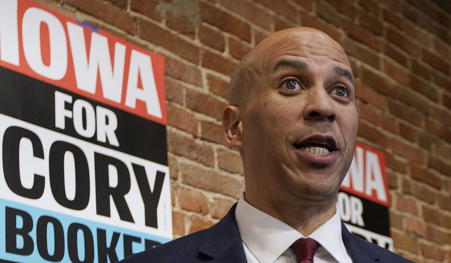 In this Dec. 5, 2019 photo, Democratic presidential candidate Sen. Cory Booker, D-N.J. speaks to reporters before a campaign stop in Council Bluffs, Iowa. (AP Photo/Nati Harnik) ** FILE **