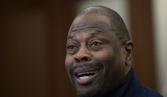 "Georgetown head coach Patrick Ewing speaks during an NCAA college basketball media availability, Wednesday, Dec. 11, 2019, in Washington.  It was hard not to do a double-take when Georgetown basketball coach Patrick Ewing replied to a question Wednesday about whether his full roster will be available for the team's next game, against Syracuse, by saying, ""As of now, yes."" That'll be the Hoyas' first home contest since legal matters involving players came to light.(AP Photo/Nick Wass)"