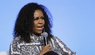 Former U.S. first lady Michelle Obama speaks during an event for Obama Foundation in Kuala Lumpur, Malaysia, Thursday, Dec. 12, 2019. Obama and actress Julia Roberts attend inaugural Gathering of Rising Leaders in the Asia Pacific organized by the Obama Foundation. (AP Photo/Vincent Thian) ** FILE **