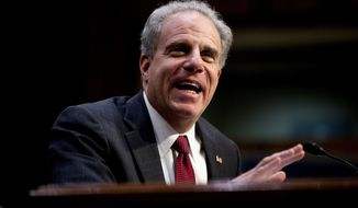 Department of Justice Inspector General Michael Horowitz testifies at a Senate Judiciary Committee hearing on the Inspector General's report on alleged abuses of the Foreign Intelligence Surveillance Act, Wednesday, Dec. 11, 2019, on Capitol Hill in Washington. (AP Photo/Andrew Harnik)