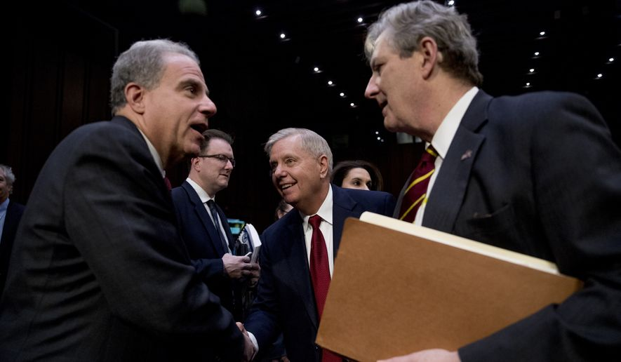 Department of Justice Inspector General Michael Horowitz, left, speaks with Chairman Lindsey Graham, R-S.C., center, and Sen. John Kennedy, R-La., right, after testifying at a Senate Judiciary Committee hearing on the inspector general's report on alleged abuses of the Foreign Intelligence Surveillance Act, Wednesday, Dec. 11, 2019, on Capitol Hill in Washington. (AP Photo/Andrew Harnik)