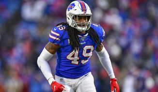 FILE - In this Nov. 24, 2019, file photo, Buffalo Bills middle linebacker Tremaine Edmunds (49) prepares for the snap against the Denver Broncos during the fourth quarter of an NFL football game, in Orchard Park, N.Y.  Ferrell and Felicia Edmunds can't lose. Nor can they be prouder when the Pittsburgh Steelers host the Buffalo Bills on Sunday night, Dec. 15. It's a game that will feature all three of the Edmunds' sons _ the Steelers' Terrell and Trey Edmunds and the Bills' Tremaine _ facing off against each other. (AP Photo/Adrian Kraus, File)