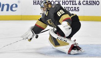 Vegas Golden Knights goaltender Marc-Andre Fleury defends against the Chicago Blackhawks during the first period of an NHL hockey game, Tuesday, Dec. 10, 2019, in Las Vegas. (AP Photo/David Becker)