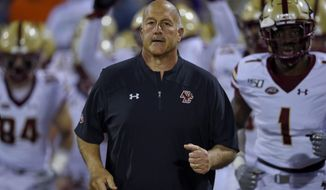 FILE - In this Oct. 26, 2019 file photo Boston College head coach Steve Addazio leads his team onto the field before the start of an NCAA college football game against Clemson in Clemson, S.C. Colorado State has hired Addazio as its head football coach. Addazio wasn't out of work long after being fired by Boston College on Dec. 1. He was 44-44 in seven seasons with the Eagles. The 60-year-old steps in for Mike Bobo, who resigned last week after reaching a financial settlement with Colorado State. Bobo is now the offensive coordinator at South Carolina. Addazio inherits a Colorado State team that is coming off a second straight losing season. (AP Photo/Richard Shiro)